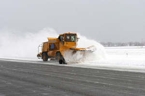 Snowplough working through the weather disruption at Heathrow