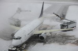 Plane in the snow on Heathrow runway